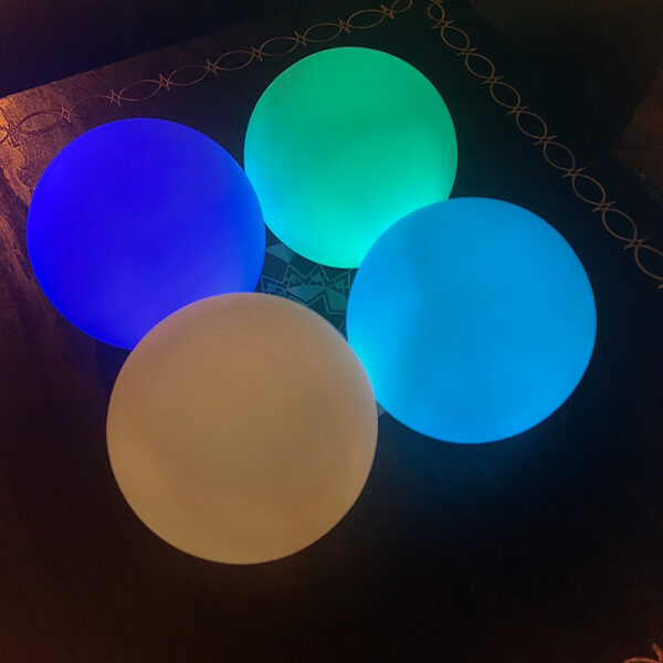 "These handheld glowing spheres emit many different colors of mesmerizing light that accentuate chakra alignment by way of the color therapy included by personal trainer Jack Kirven in the energy cleansing workshop ""The 49 Professions of Joy."""